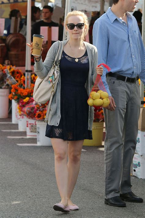 DOVE CAMERON Shopping at Farmer's Market in Los Angeles